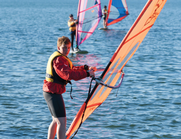 Children windsurfing on a great school camp in Brisbane
